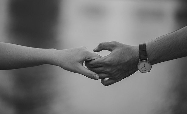 monochrome-photo-of-couple-holding-hands-1004014.jpg